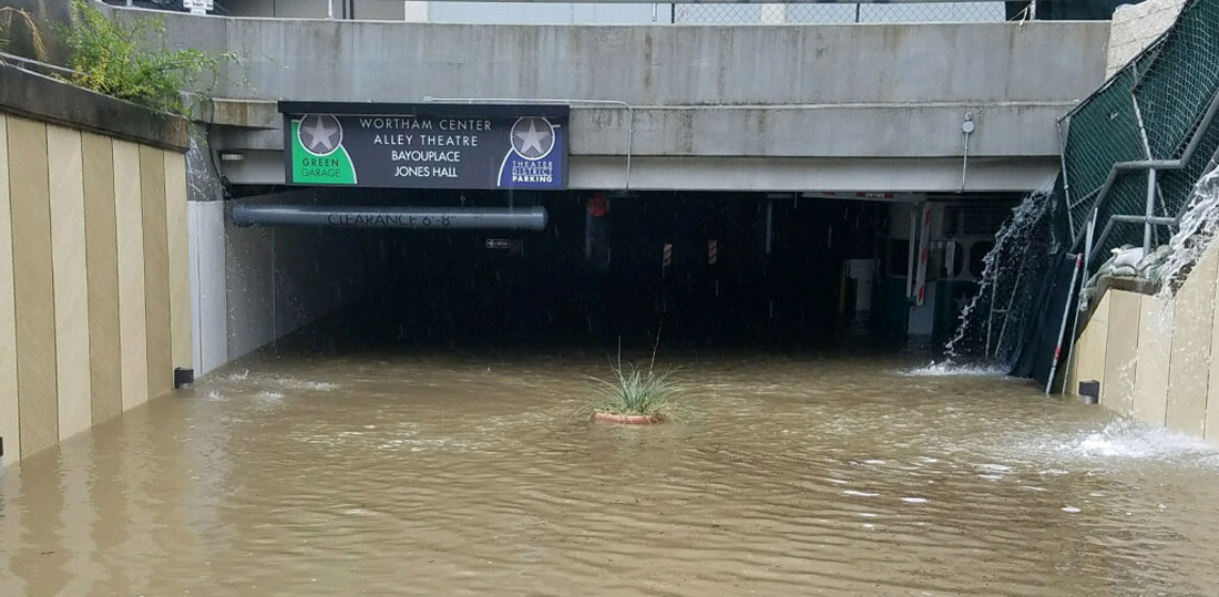 A heavily flooded underground parking facility in Houston's theater district.