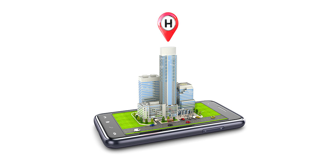 A model of a high-rise hospital placed on a smartphone screen. 3D illustration.