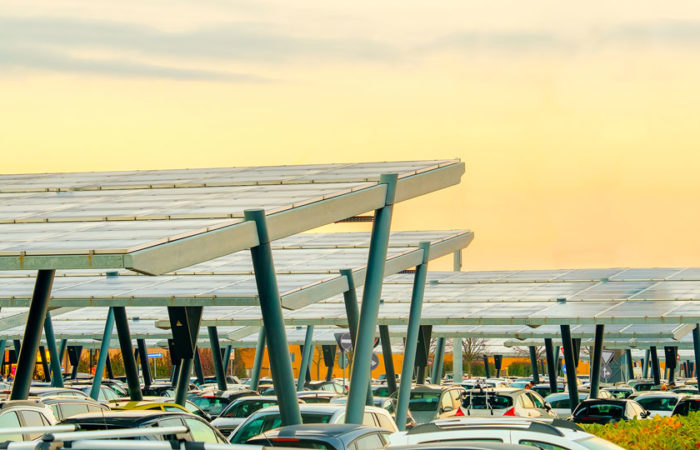 Solar panel canopies covering a large surface parking lot.